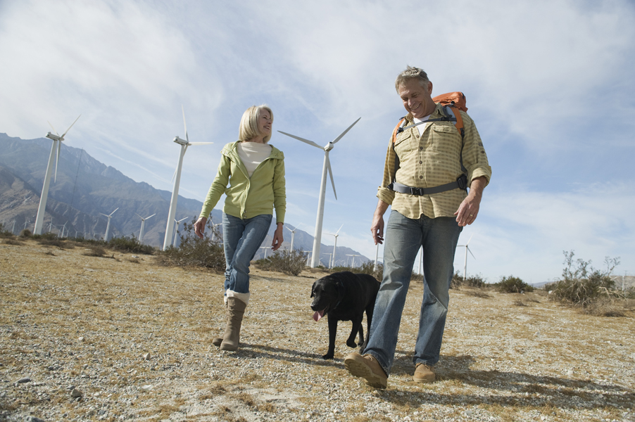 Employees hike along the wind farm.